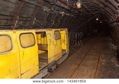 Mine railway in undergroud. Modern coal mine . Real underground post mine illuminated tunnel .