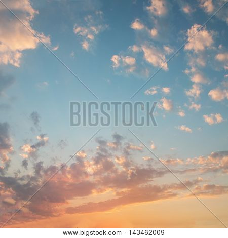 beautiful sunset sky in orange and blue colors square format