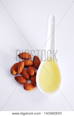 almond oil and almond seed isolated on white background