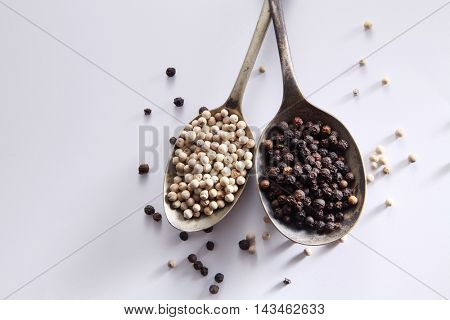 black and white peppercorn on the white background