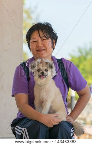 Asia Woman And Her Dog At Estuary (river Side And Sea)