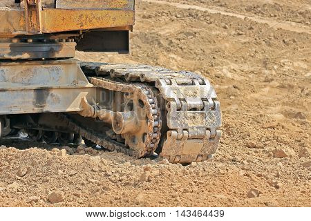 Caterpillar mover of tractor. Caterpillar tractor on a clay pit