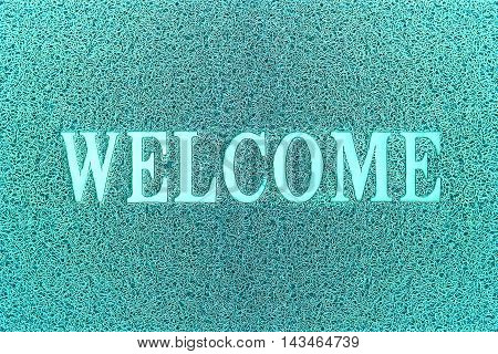 Welcome Cyan Door Mat. Welcome Carpet Background. Welcome Cyan Sign.