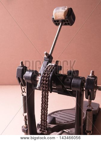 Old Pedal drum on brown background .