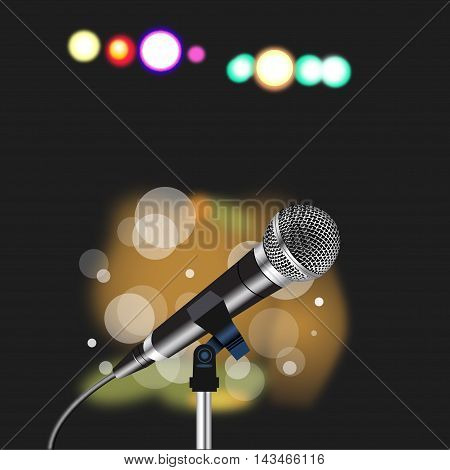 Microphone with a cord on abstract  Spotlight background