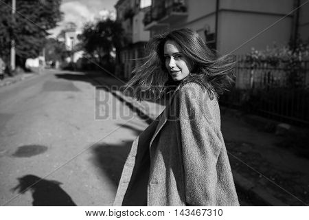 young beautiful girl walking down the street