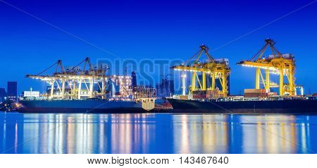 Industrial Container Cargo freight ship with working crane.