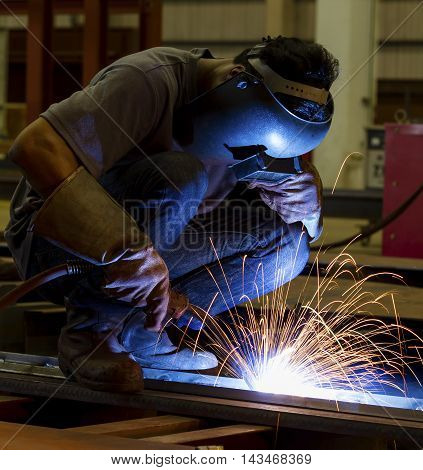 Welding and bright sparks. Concept and idea of hard job