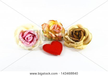 paper flowers and red heart on White background