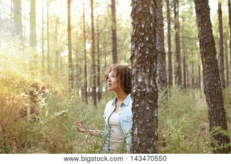 Young Girl Listening In The Woods