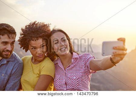 Friends Taking A Selfie On A Mountain
