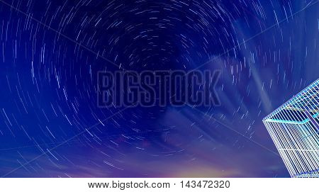 star trail in the sky with clouds