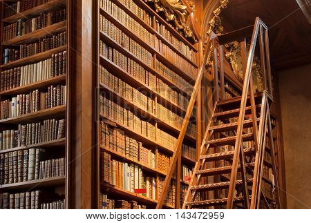 VIENNA, AUSTRIA - MAY 30, 2016: Old bookcase with the leather-bound book covers in the Austrian National Library on May 30, 2016 in Vienna. Est in 18th century the largest library in Austria with 7.4 mill items