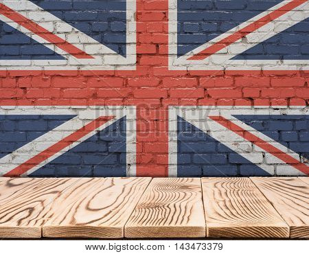 United Kingdom flag painted on brick wall with wooden floor