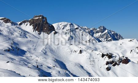 Snow covered mountains and ski slopes in Flumserberg Switzerland.