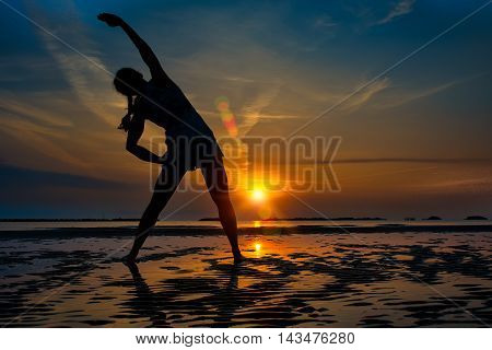 Girl Alone Fitness Practice In A Sunrise At The Beach