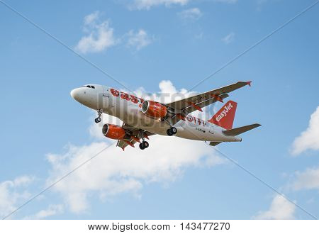 LUTON UK - 03 AUGUST 2016: Jet plane of low cost airlines Easyjet landing at London Luton airport