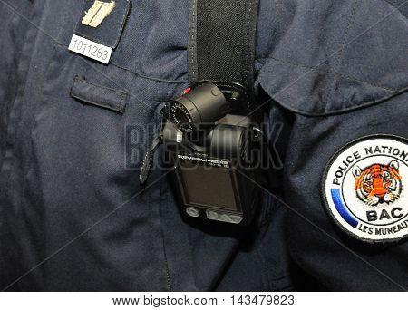 Les Mureaux France - april 8 2016 : close up of a security camera on a policeman uniform