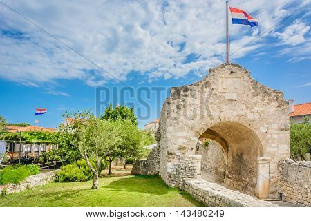 View at lower stone gate in ancient town Nin, marble little town in Croatia, european travel place.