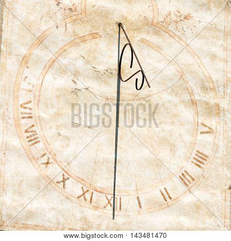 antique restored sundial with roman numeral indicating twelve