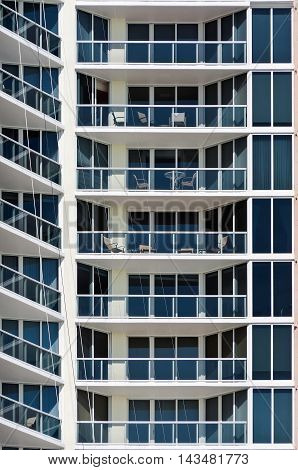 New Modern apartment house - this is a vertical color photograph of a high rise Miami Beach apartment building. The detailed shot shows the repetition of balconies.
