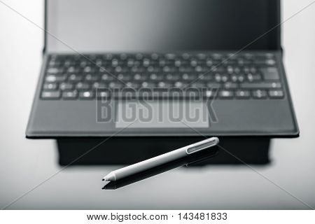 Tablet With Pen On Shiny Surface