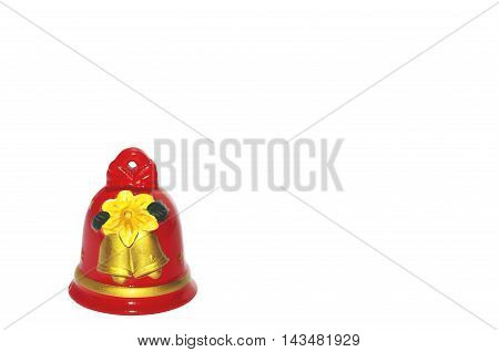 Red, bright , Christmas bell ceramic on white background, closeup