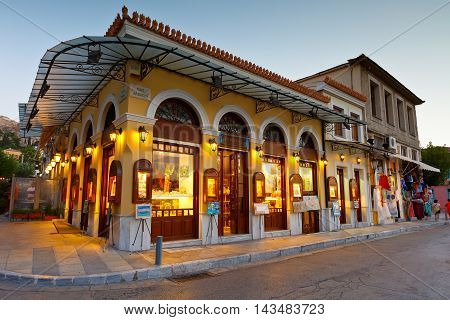 ATHENS, GREECE - AUGUST 20, 2016: Typical old Athenian architecture in the old town of Plaka which are now used as shops and coffee shops on August 20, 2016.