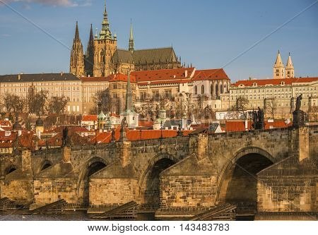 Charles Bridge close up and St Vitus Cathedral in background - Close up with the stone built Charles Bridge and the St. Vilus Cathedral, surrounded by other historical buildings, in the background.
