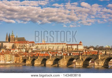 Charles Bridge in Prague, Czech Republic - Cityscape in Prague, the capital of Czech Republic, with Charles Bridge under a blue sky with white clouds.
