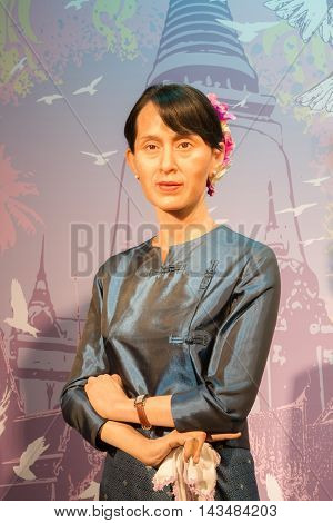 BANGKOK THAILAND - DECEMBER 19: Wax figure of the famous Aung San Suu Kyi from Madame Tussauds on December 19 2015 in Bangkok Thailand