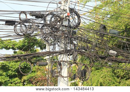 Messy cable electricity post due to poor planning on installing the cable system.