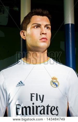 BANGKOK THAILAND - DECEMBER 19: A waxwork of Cristiano Ronaldo on display at Madame Tussauds on December 19 2015 in Bangkok Thailand.