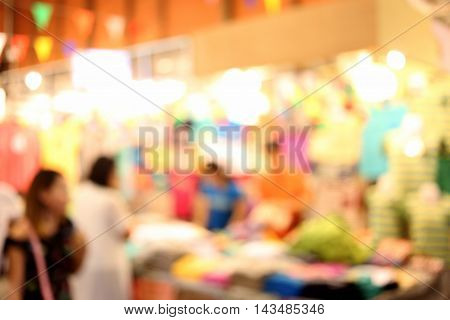 blur clothing store night and have lamp lighting for design background.