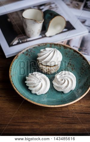 French meringue cookies on a plate, selective focus