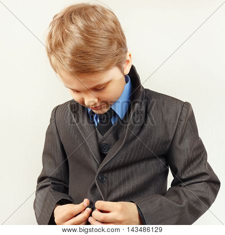Little cute gentleman fastened his elegant suit