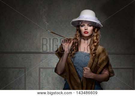 portrait of 1940s woman wearing hat and smoking