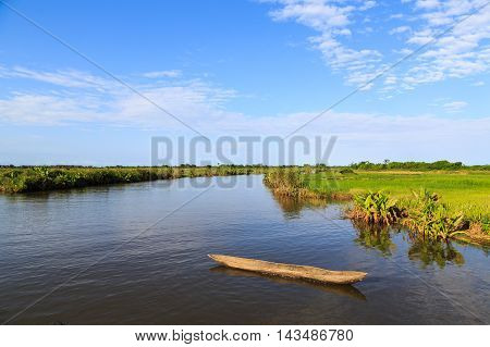 River Running Through A Beautiful Tropical Green Landscape On A Sunny Day In Africa