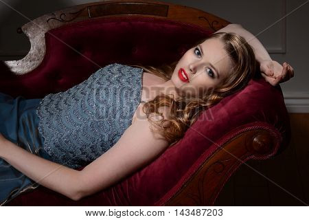 closeup portrait 1940s woman laying on couch