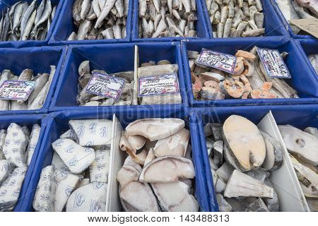 Group of fish served on ice on the market