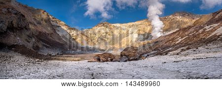Big rocks on the eternal snow inside Mutnovsky volcano crater, Kamchatka, Russia