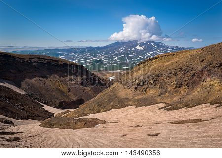 Eternal snow in a rocky canyon on Mutnovsky Volcano, Kamchatka, Russia