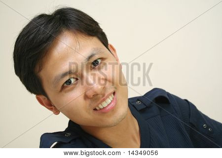 Portrait of good looking young asian man.