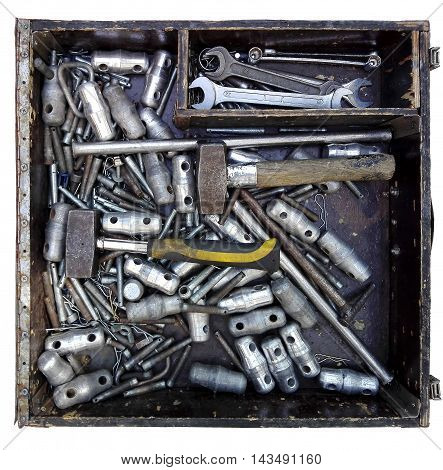 Photo of a box with various tools and fasteners.