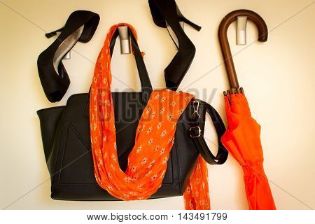 Sexy black shoes,bag, sash and umbrella isolated on white background
