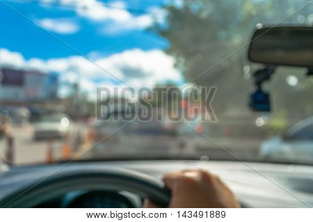 blur image of people driving car on day time for background usage.(take photo from inside)