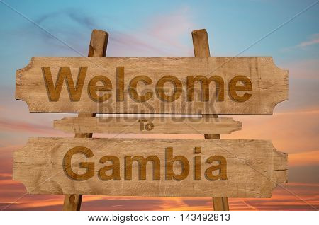 Welcome To Gambia Sing On Wood Background