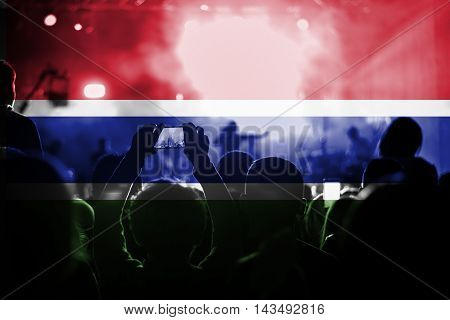 live music concert with blending Gambia flag on fans