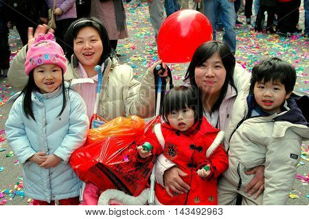 New York City - February 9. 2005: Mothers with their children celebrating the Chinese Lunar New Year on Mott Street in Chinatown