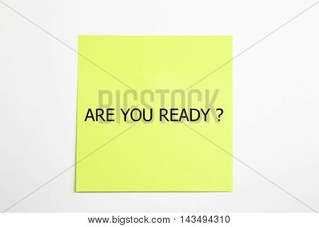 are you ready? word written on sticky notes. isolated on white